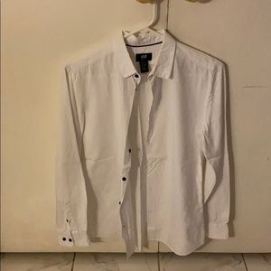 white button up shirt with black buttons